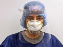 Someone in personal protective equipment (PPE)